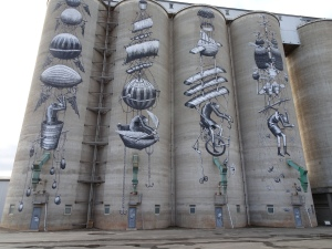 the doors at the bottom of the silos gives the scale