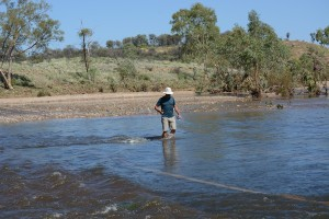 Wading across the Finke 24 hours after arriving in Glen Helen