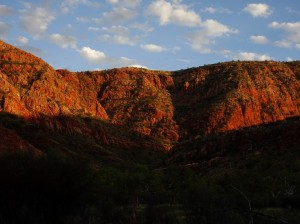 Ormiston Gorge's cliffs blazing in the dawn's rise