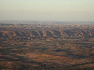 View across the West Macdonnell ranges to to Tnorala in the distance