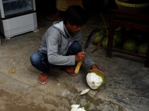 Cutting up a coconut for me