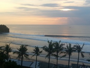 Famous Balangan surf rolling in during a beautiful sunset