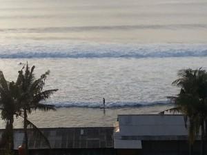 Surfer coming right into shore at Balangan Beach
