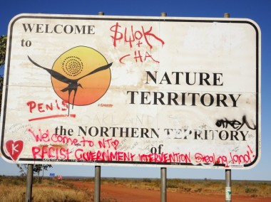 Political graffiti on the Welcome to NT sign