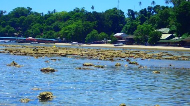 Low tide view of the little settlement up the beach from Panorama