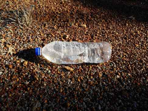 Who throws out a near full bottle of water?